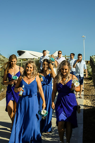 Beach Wedding | Amanda's bridesmaids wore brilliant blue