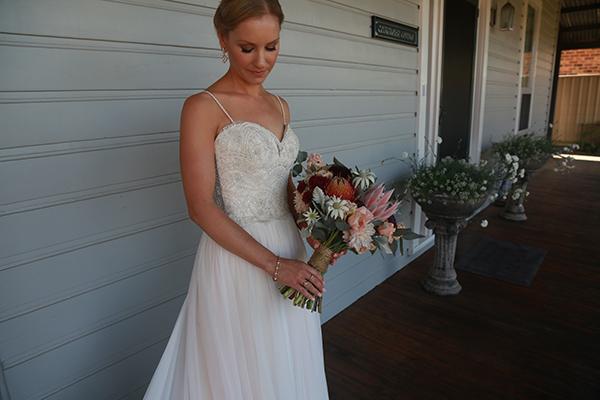 Beautiful bride Jodie wore a bespoke blush wedding dress