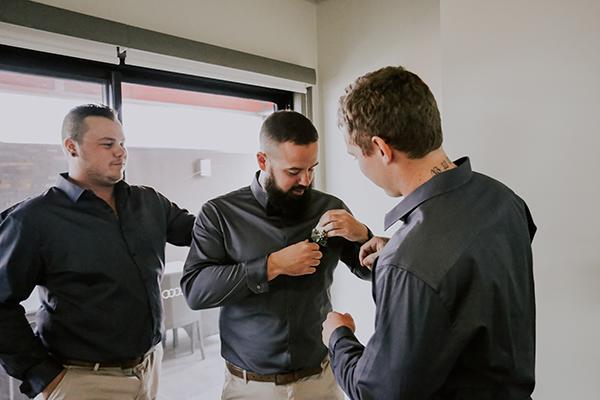 The groom and groomsmen prepare