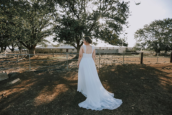Brianna wore a custom Peter Trends bridal gown