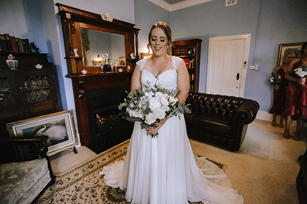 Brianna wore a Peter Trends gown for her rustic country wedding