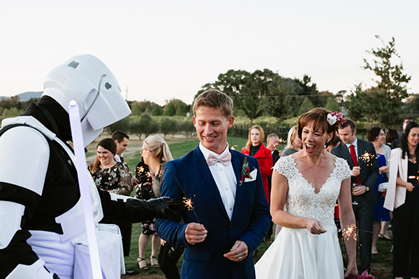 Bride and groom are greeted by Star Wars Storm Troopers